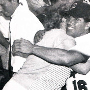 All-Star Game hero and Mass Envelope Manager Jim Mello receives a congratulatory hug from his mother following his explosive game-winning home run in the last of the eight at Fenway Park.