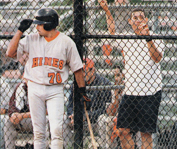 Ernesto Orledo of Hines/ADSL waits on deck for his turn at the plate.