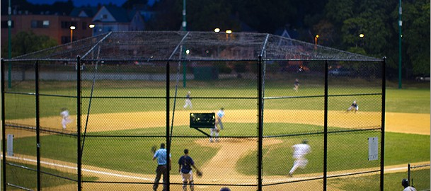 Jim Murphy, a retiree from West Roxbury, enjoyed a free front-row seat for a game at Fallon Field in Roslindale Wednesday night. ((Dina Rudick/Globe Staff)